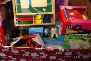 toys in a large Christmas box